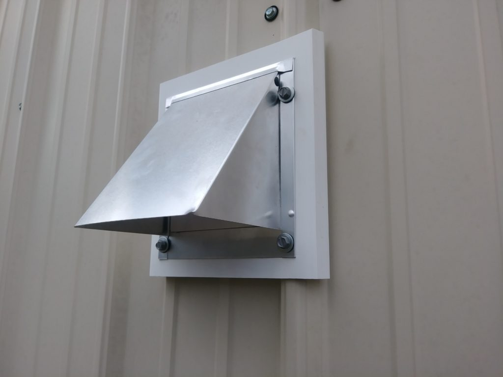Install And Exterior Vent On Corrugated Metal Siding